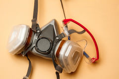 Respirator mask on the wall. Mask respirator and goggles on the wall. Copy space stock photos