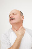 Respiratory disease in older age. Man has sore throat infection and colds stock photography