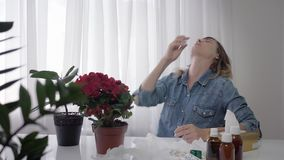 Respiratory diseases, adult girl is allergic to pollen, constantly sneezing and wiping her eyes and wipes, achoo. Respiratory diseases, a adult girl is allergic stock video footage