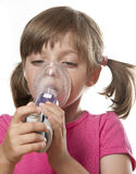 Respiratory problems. Ill little girl with inhaler - respiratory problems Stock Photos