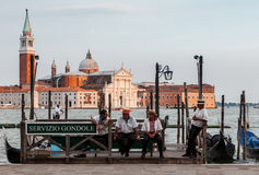 Respite Moment. Venice,Italy,July 30 2011: Image of gondoliers having a respite moment at the end of the workday in the evening near the Grand Canal on San Marco Stock Photos