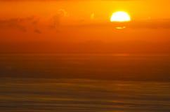 Resplandor de la salida del sol del océano Imagenes de archivo