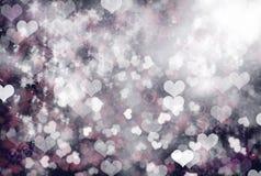 Resplandor del amor - fondo de los corazones de la chispa Fotografía de archivo