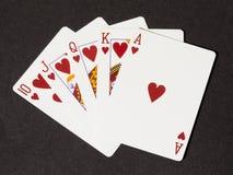 Resplendor real dos corações na lona preta Imagem de Stock Royalty Free