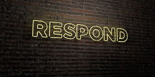 RESPOND -Realistic Neon Sign on Brick Wall background - 3D rendered royalty free stock image Royalty Free Stock Photos