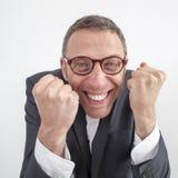Responsabile vizioso che gode del successo corporativo con energia ed umore fotografia stock