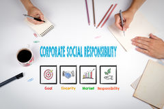 Responsabilidade social empresarial A reunião na tabela branca do escritório fotografia de stock royalty free