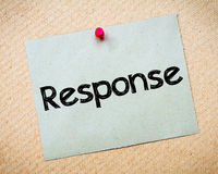 Response. Message. Recycled paper note pinned on cork board. Concept Image Stock Photo