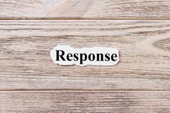 RESPONSE of the word on paper. concept. Words of RESPONSE on a wooden background.  Royalty Free Stock Image