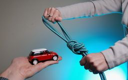 Responsibility. A toy car and the rope Royalty Free Stock Photos