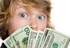 Responsibility. A boy peers over a handful of American money Stock Photo