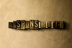 RESPONSIBILITY - close-up of grungy vintage typeset word on metal backdrop Stock Photo