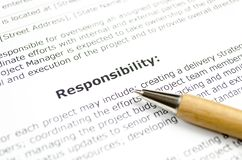 Responsibility with wooden pen royalty free stock photography