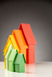 Responsible Living - Energy Label for Homes. Seven small paper houses in the colors of the energy efficiency label stock photography