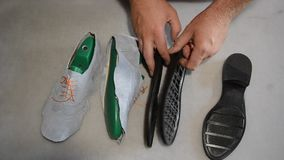 Responsible shoemaker making gray shoes stock video footage