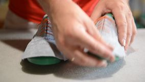 Responsible shoemaker making gray shoes stock footage