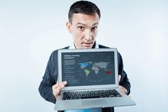 Responsible worker showing important information on his laptop Royalty Free Stock Photo