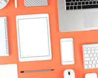 Responsive design: Keyboard, tablet and smartphone on red table Royalty Free Stock Photos