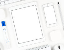 Responsive design: Keyboard, tablet and smartphone on white table Stock Photography