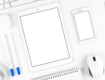 Responsive design: Keyboard, tablet and smartphone on white table Royalty Free Stock Images
