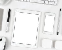 Responsive design: Keyboard, tablet and smartphone on white table Stock Image