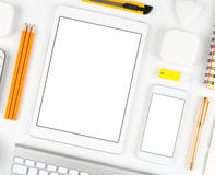 Responsive design: Keyboard, tablet and smartphone on white table Stock Images