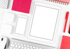 Responsive design: Keyboard, tablet and smartphone on white table Royalty Free Stock Photos