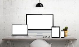 Responsive devices on desk with isolated screen for mockup. Stock Images