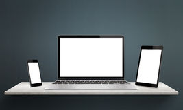 Responsive devices on desk with  screen for mockup Royalty Free Stock Photos
