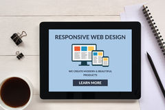 Responsive web design concept on tablet screen with office objec Royalty Free Stock Photo