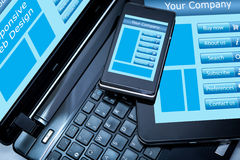 Responsive web design. On mobile devices phone, laptop and tablet pc Stock Images