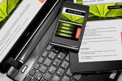 Responsive web design. On mobile devices phone, laptop and tablet pc Royalty Free Stock Photo