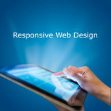 Responsive web design. On mobile devices tablet pc on blue background Royalty Free Stock Images