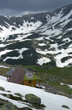 Resque cabin. Rain is coming over mountains Royalty Free Stock Images