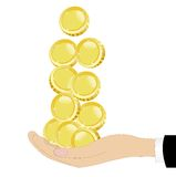 Resquicios del oro en una mano en un fondo blanco Imagen de archivo libre de regalías