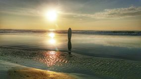 Ressaca do por do sol Imagem de Stock