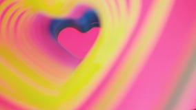 Ressort battant coloré d'arc-en-ciel de coeur Concept de jour du ` s de Valentine Mouvement lent de cadre rose de coeur Signe de  illustration libre de droits