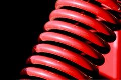 Ressort hélicoïdal rouge Photo stock