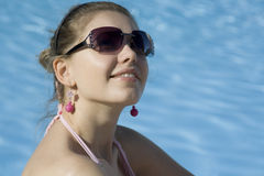 Rest 15. Beautiful young woman near a pool stock images