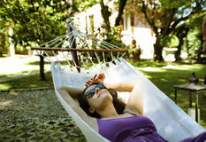 Rest. Young woman having rest on a  hammock Stock Photo