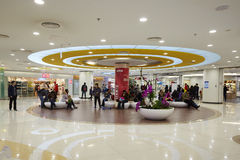 Rest area in fashion mall. People sitting and rest at relaxing area, Beijing Tianhong Shopping Mall, interior panorama view Royalty Free Stock Images
