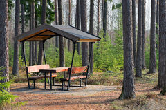 Rest area in the forest besides the highway Royalty Free Stock Photos