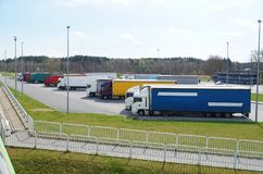 Weekend break in drivers` work. Rest area filled with lorries. Rest area. Other names: motorway service area, travel plaza, rest stop, service area, service royalty free stock photos