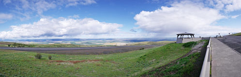 Rest Area Panoramic View. The rain clouds are at eye level while observing the scenic view on top of Emigrant Hill in Eastern Oregon. Emigrant Hill, commonly Stock Image