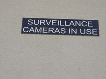 Rest stop surveillance camera in use sign. Rest area sign designating the area has surveillance cameras on site Stock Image