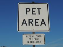 Rest stop pet area with leashes sign. Rest area sign designating the pet area for animals on a leash Royalty Free Stock Photography