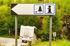 Rest area and tourist information sign. Rest stop area and tourist information sign outdoor on norwegian nature. Camper car on roadside in the background stock images