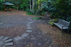 Rest area of Wendy Whiteley`s Secret Garden with stepping stones concrete. Wendy`s Secret Garden is located at Lavender Bay on the lower North Shore of Sydney Stock Image
