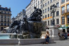 Rest around renewed Bartholdi Fountain on Place des Terreaux. LYON, FRANCE, May 6, 2018 : The brand renewed Bartholdi Fountain on Place des Terreaux Stock Photography