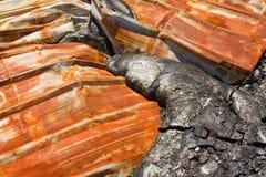 Rest av ett hus som begravas under lava Fotografering för Bildbyråer